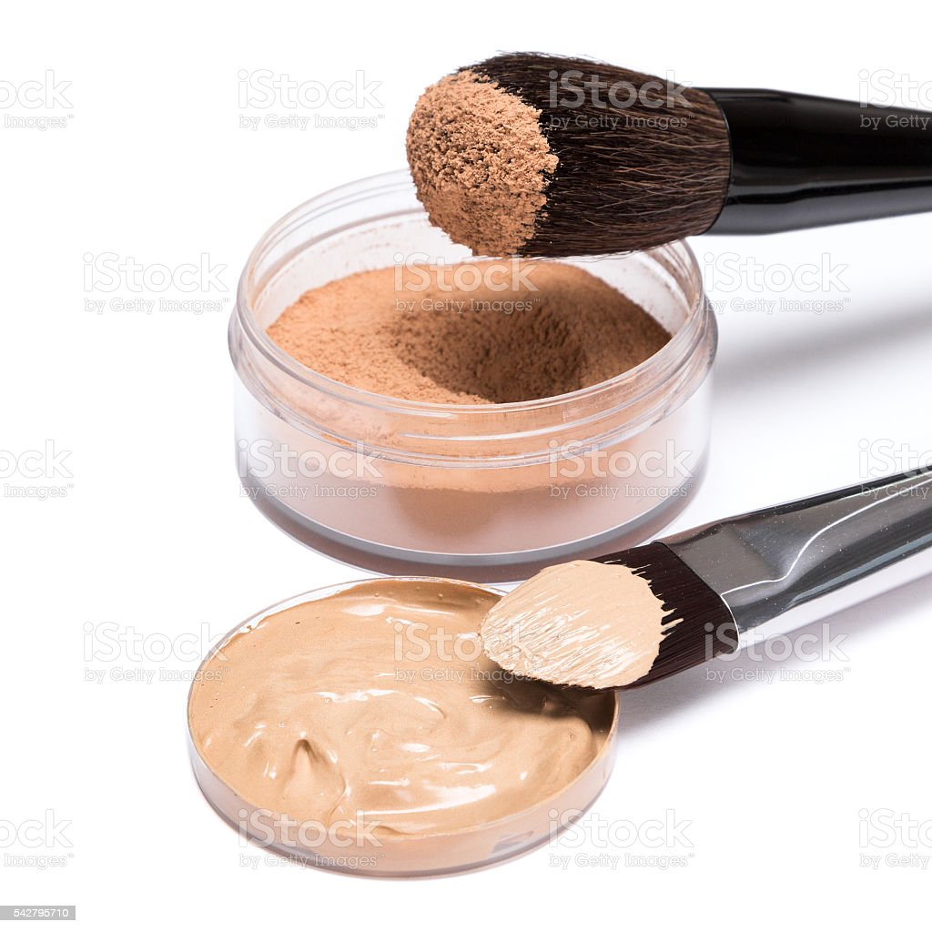 Foundation and loose cosmetic powder with brushes stock photo