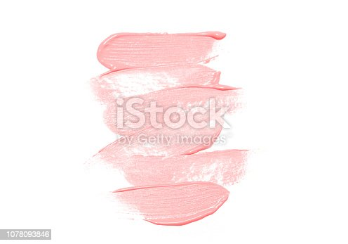 istock Foundation creamn smear texture colored in color of year 2019 Living Coral. Bright Macro color 16-1546 1078093846