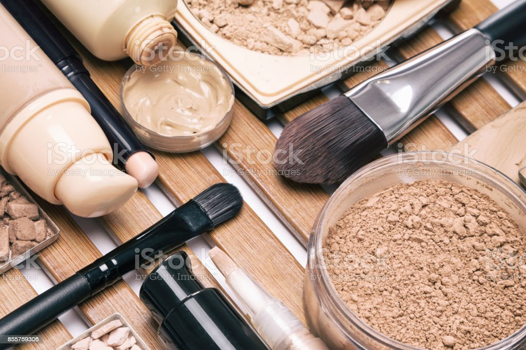 Foundation make up products with brushes stock photo
