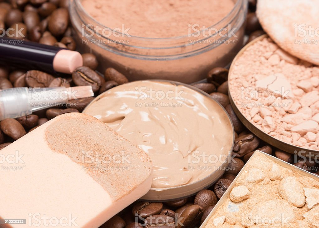 Foundation makeup products on coffee beans stock photo