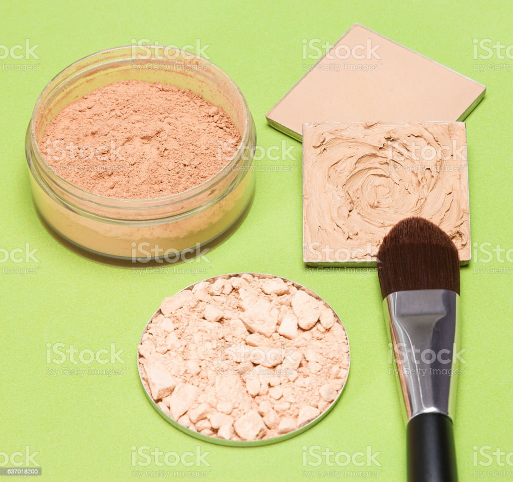 Foundation makeup products with flat brush stock photo