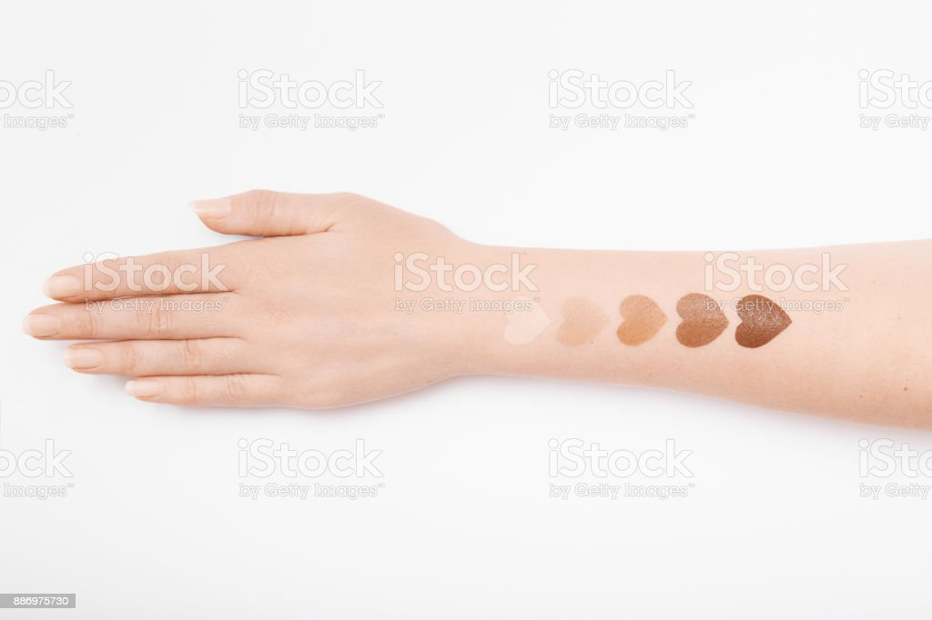 Foundation makeup swatches on female hand stock photo
