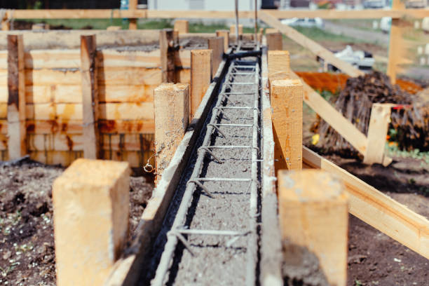 Foundation site of new building - construction industry details, cement and concrete building stock photo