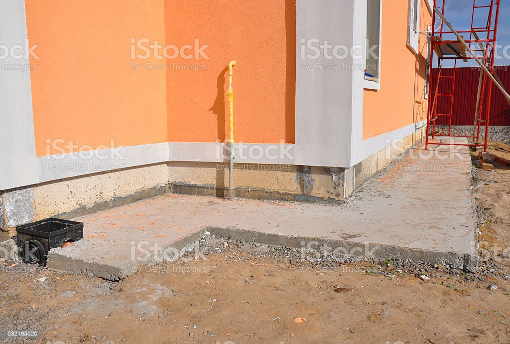 Foundation wall waterproofing, drainage, gas pipe, colorful facade stock photo