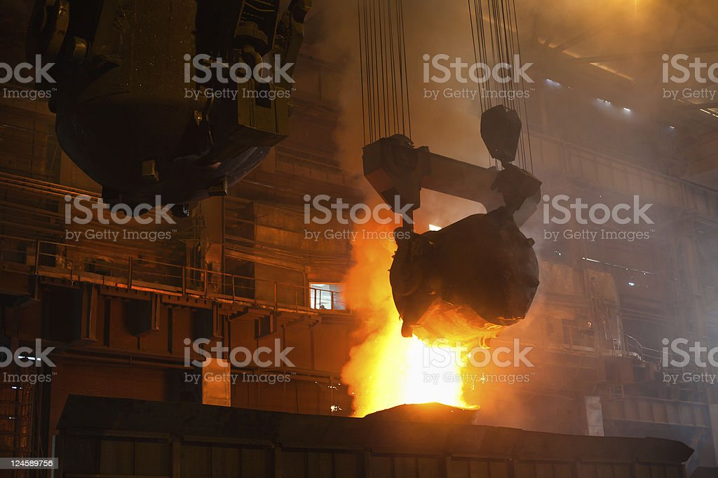 Foundry with large fire and making liquid metal  stock photo