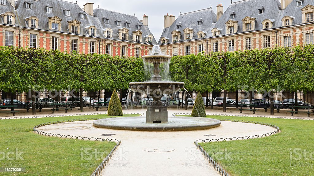 Fountain and grounds of the Place des Vosges stock photo
