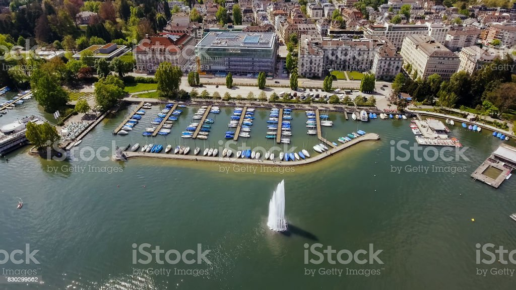 Fountain And Luxury Marina Boats In Zurich Switzerland Aerial View stock photo