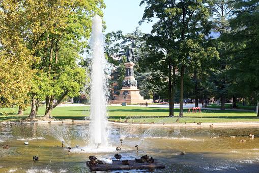 Fountain and monument statue of Dante Alighieri in park Giardini Pubblici in Trento, Italy
