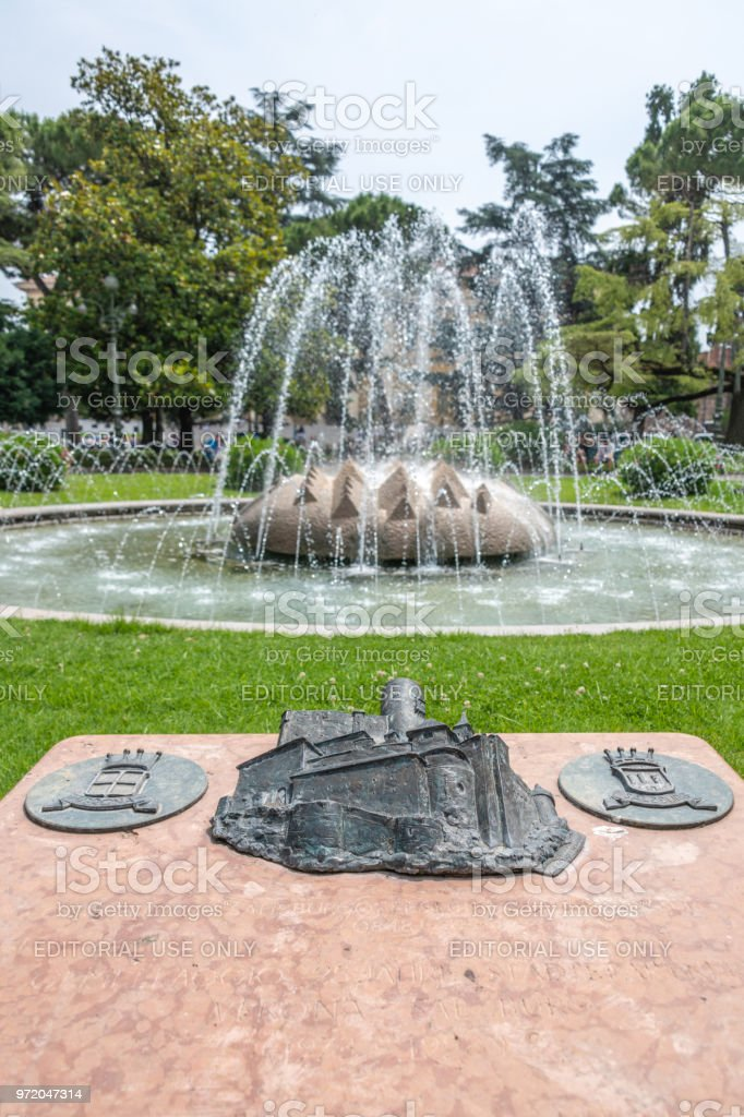 Fountain and plaque in Verona, Italy stock photo