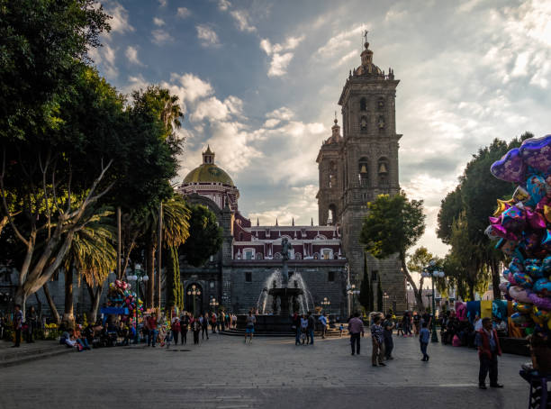 Fountain and Puebla Cathedral at sunset - Puebla, Mexico Puebla, Mexico - Oct 2016: Fountain and Puebla Cathedral at sunset - Puebla, Mexico puebla state stock pictures, royalty-free photos & images