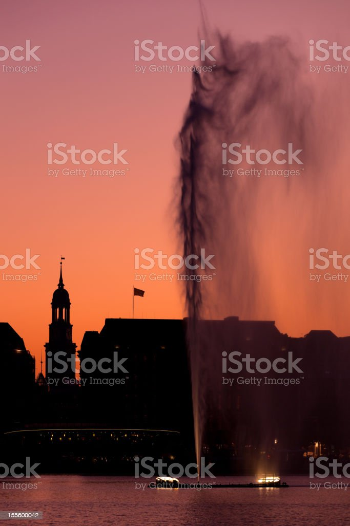 fountain and silhouette stock photo