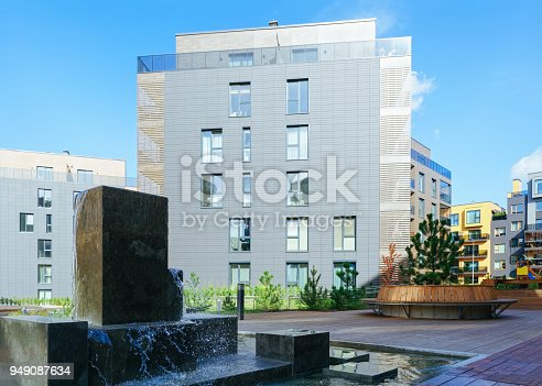 949087660 istock photo Fountain at architectural complex of residential building quarter 949087634