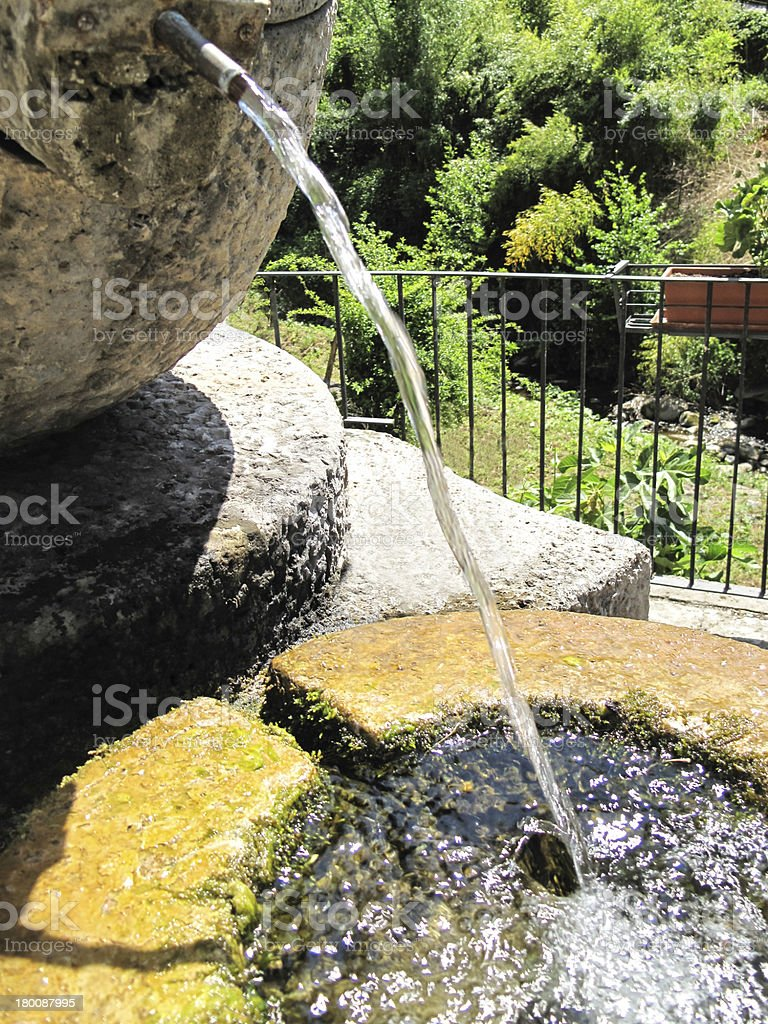 Fountain from a vase stock photo