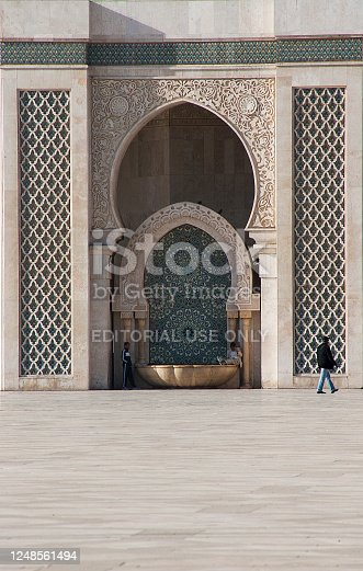 Casablanca, Morocco - November 07, 2016: People around a fountain in the Courtyard of Hassan 2 Mosque in Casablanca, the largest in Morocco. Its Minaret is the world Tallest at 210 meters.