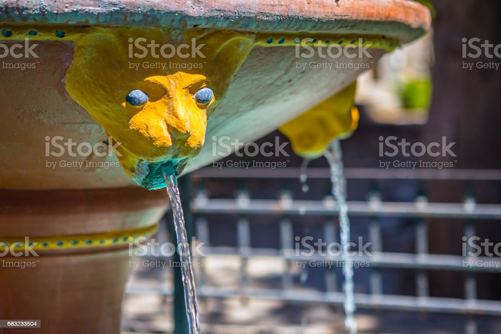Fountain in front of monastery of Mother Mary Vidiani in Crete. Greece royalty-free 스톡 사진