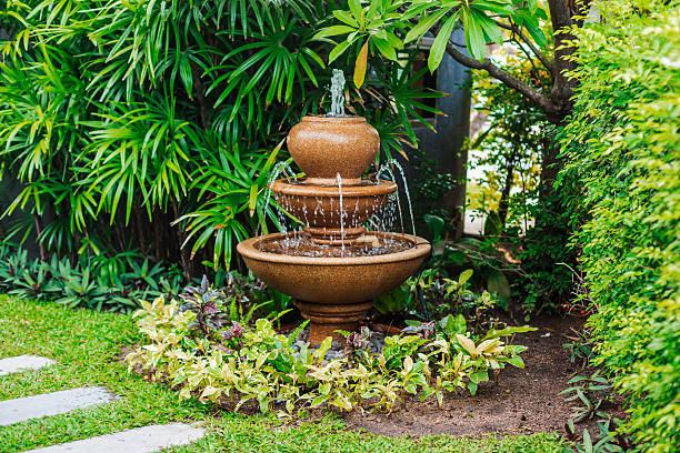 Fountain in garden stock photo