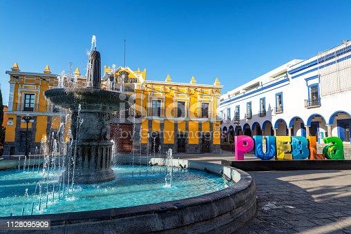 Fountain, theater, and Puebla sign in historic Puebla, Mexico
