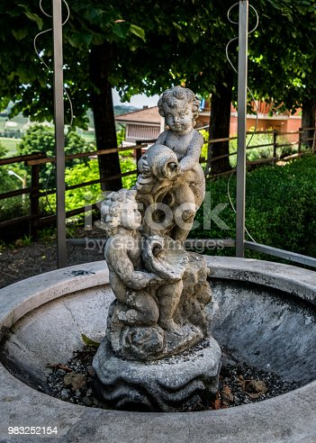 This is an abbandoned fountain in Agliano, Italy.
