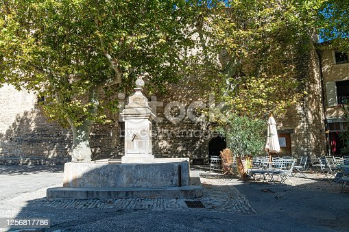 Fountain in medieval village of Gordes , Provence , France