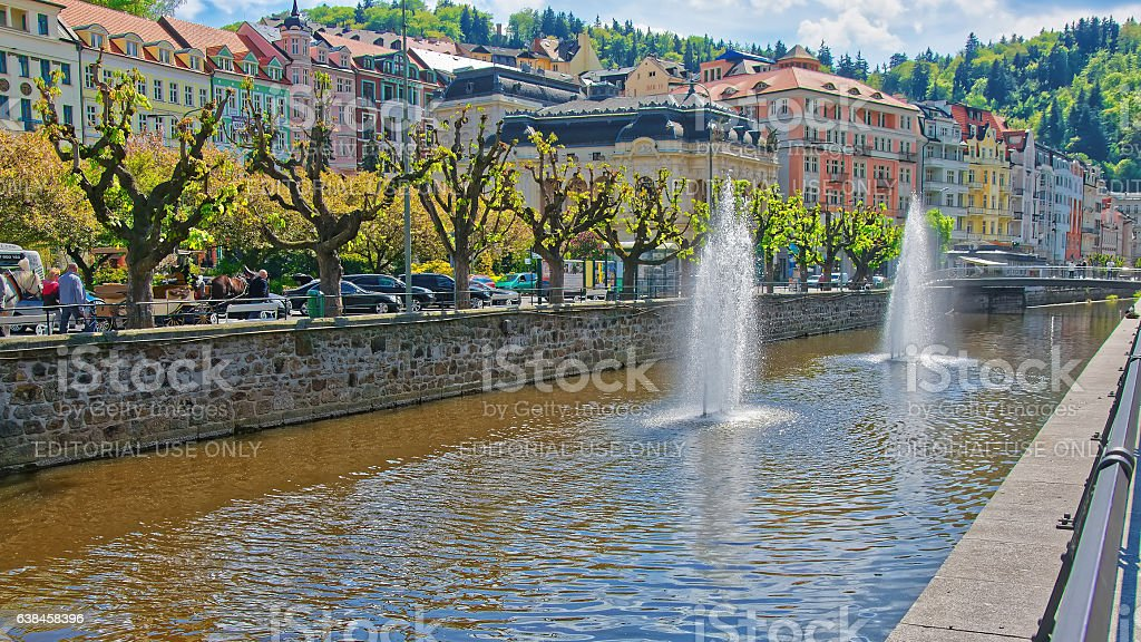 Fountain in Tepla River and Promenade in Karlovy Vary stock photo