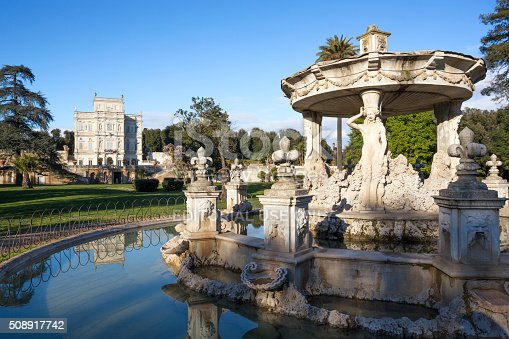 Rome, Italy-February 23, 2015: Fountain of Cupido and Cassino del Bel Respiro or Villa Doria Pamphili is a seventeenth century villa in the biggest public park in Rome. Originally owned by the Pamphili family now owned by the Italian State.