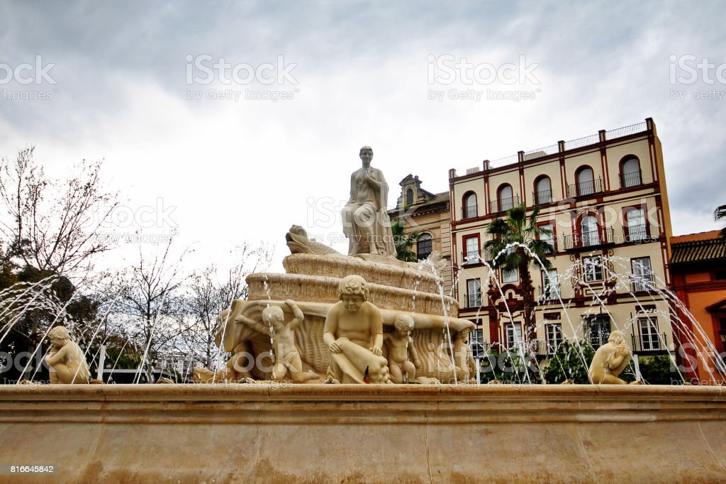 Fountain of Hispalis with nereid sea nymphs (Fuente Hispalis) in Puerta de Jerez, Seville (Sevilla), Andalusia, Southern Spain stock photo