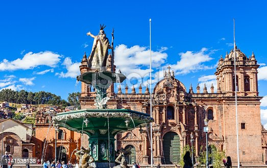 Fountain of Incan emperor Pachacuti and Cuzco cathedral at Plaza De Armas, Cuzco, Peru