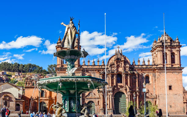 Fountain of Incan emperor Pachacuti and Cuzco cathedral at Plaza De Armas, Cuzco, Peru Fountain of Incan emperor Pachacuti and Cuzco cathedral at Plaza De Armas, Cuzco, Peru peruvian culture stock pictures, royalty-free photos & images