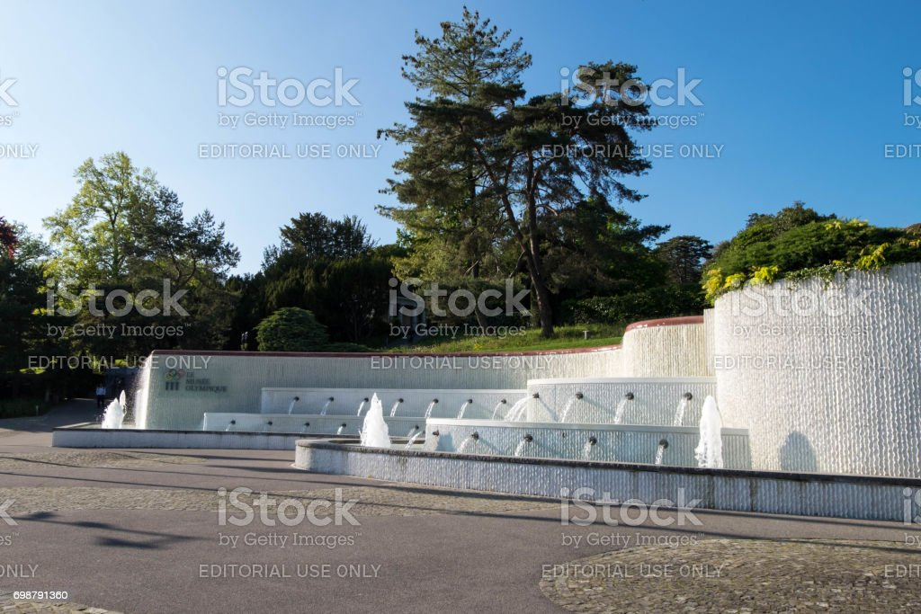 Fountain of Le Musee Olympique or Olympic museum on Quai d'Ouchy, displays modern olympic movement. stock photo