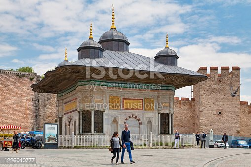 Istanbul, Turkey - May 09 2019: The Fountain of Sultan Ahmed III is a fountain in a Turkish rococo structure in the great square in front of the Imperial Gate of Topkapi Palace.