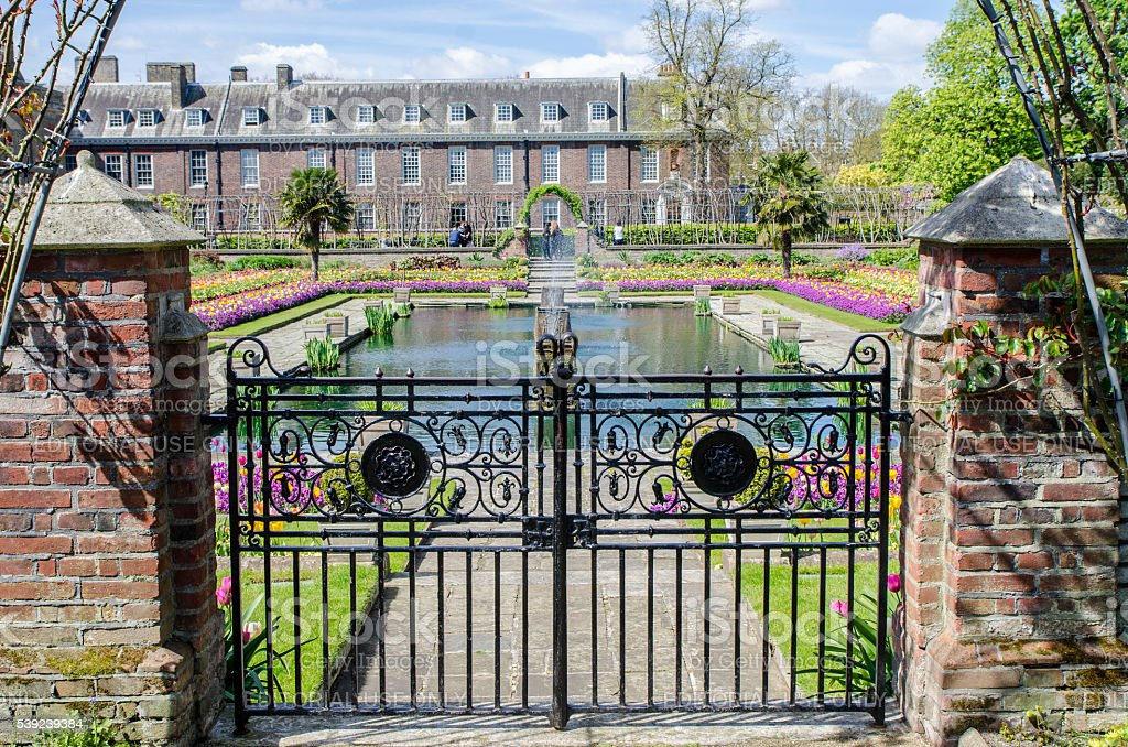 Fountain of Sunken Garden with Kensington Palace behind royalty-free stock photo