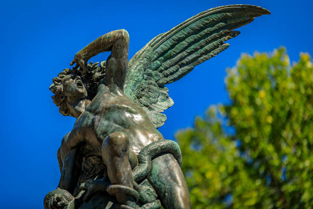 Fountain of the Fallen Angel or Fuente del Angel Caido in the Buen Retiro Park in Madrid, Spain inaugurated in 1885 stock photo