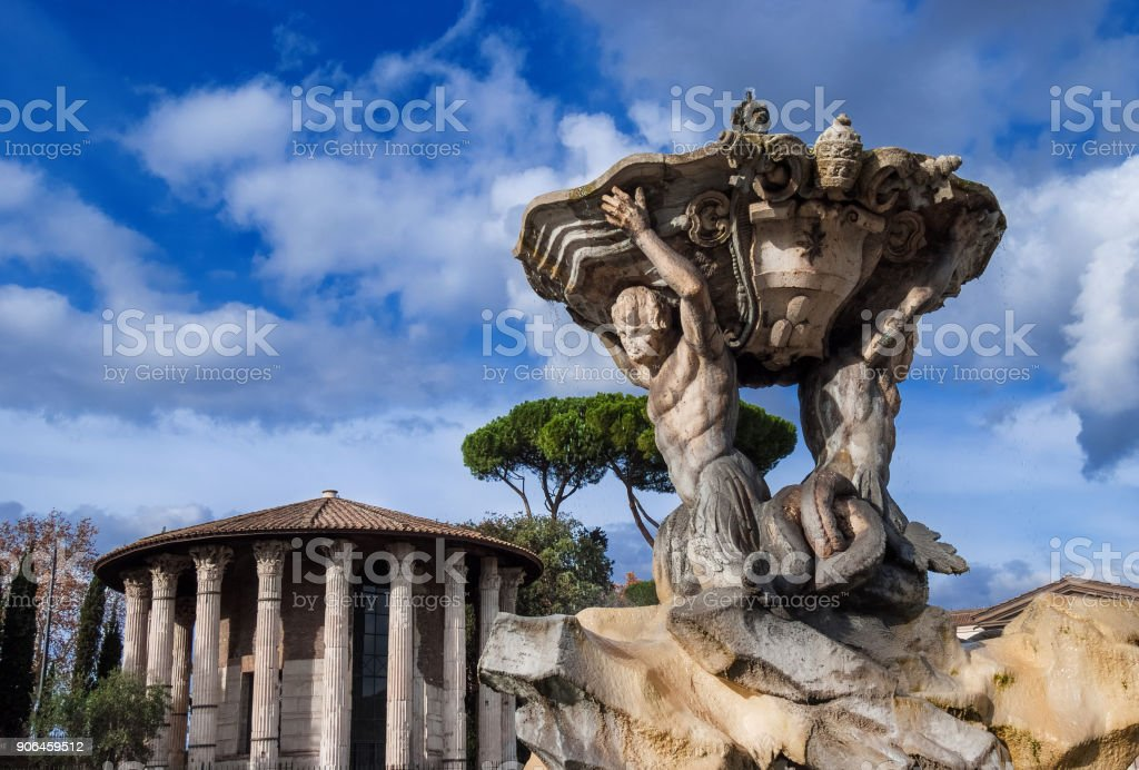 Fountain of the Tritons with Temple of Hercules Victor stock photo