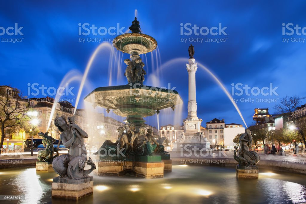Fountain on Rossio Square in Lisbon by Night stock photo