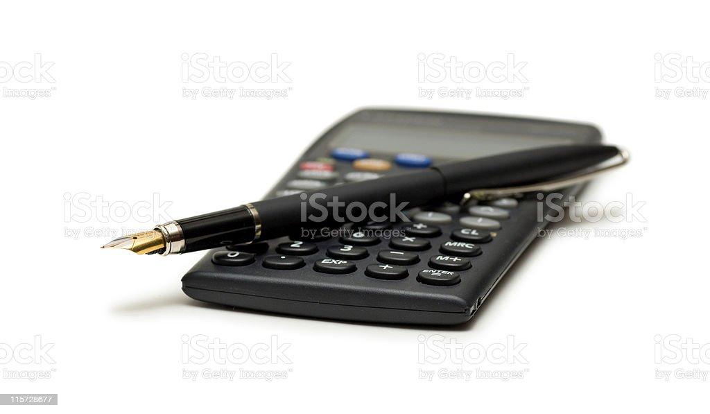 Авторучка и калькулятор на белом стоковое фото