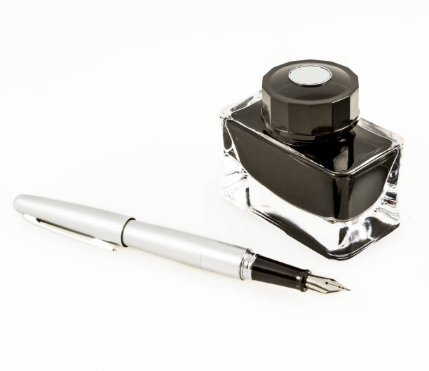 Fountain pen and inkwell stock photo