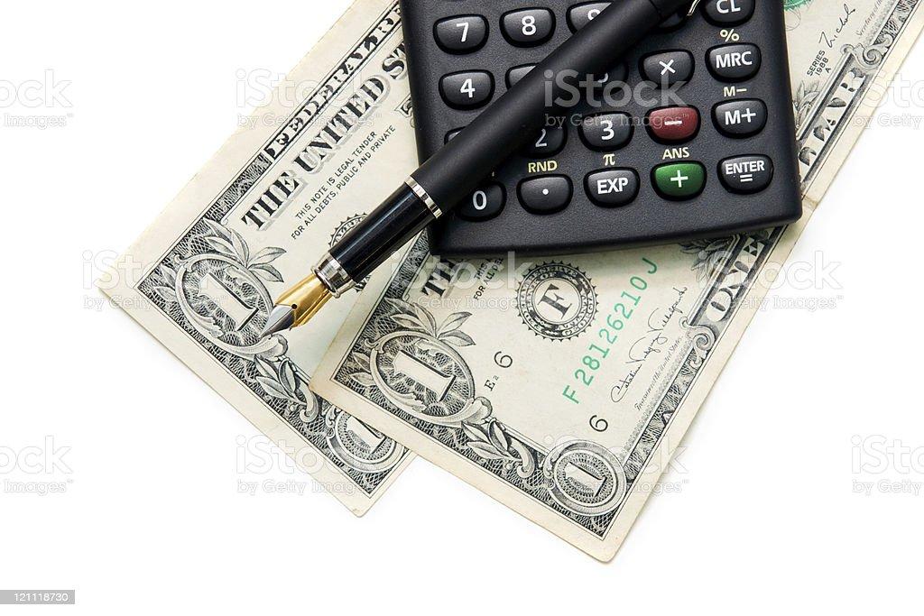 Перьевая ручка, калькулятор и доллар на белом стоковое фото