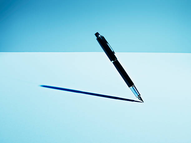 Fountain pen casting shadow stock photo