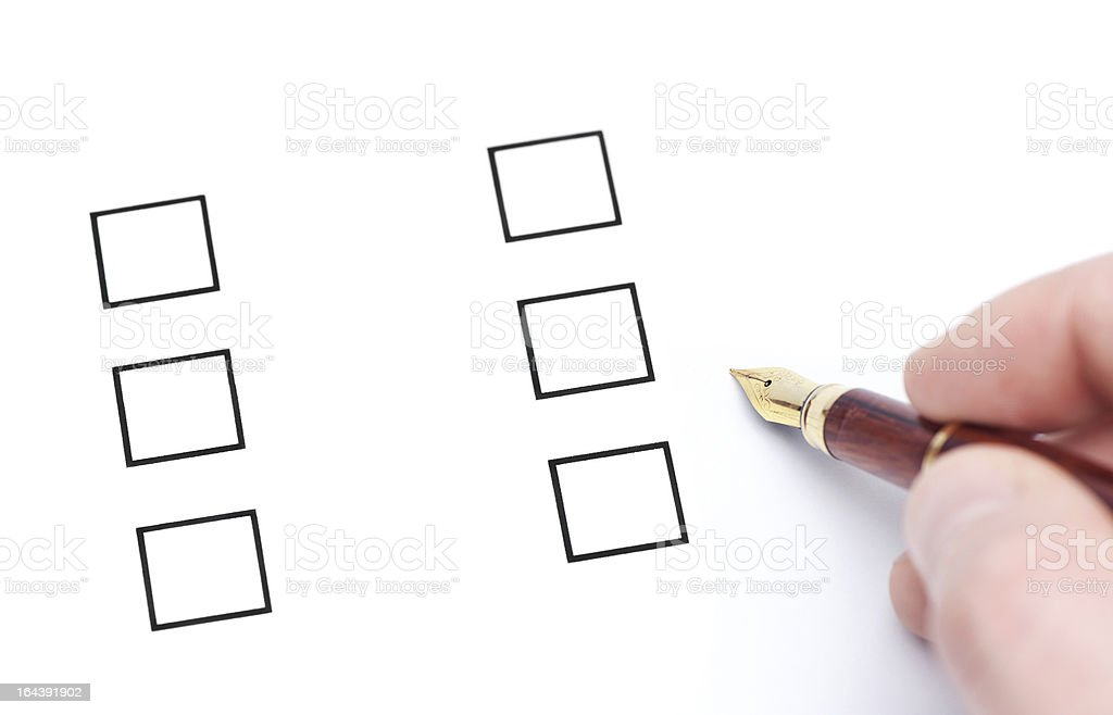 fountain pen checking the checklist boxes isolated on white background royalty-free stock photo