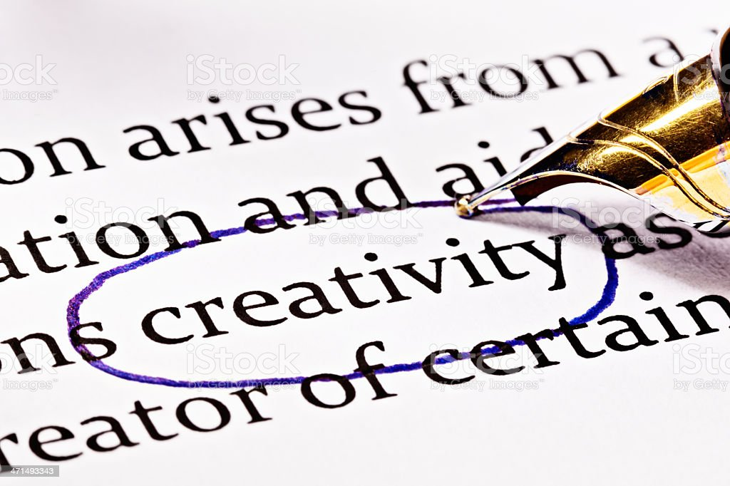 "Fountain pen circles word ""creativity"" in printed document for emphasis royalty-free stock photo"