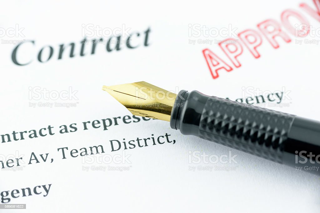 Fountain pen on an approved contract. stock photo