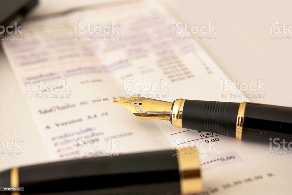 Fountain pen on bill stock photo