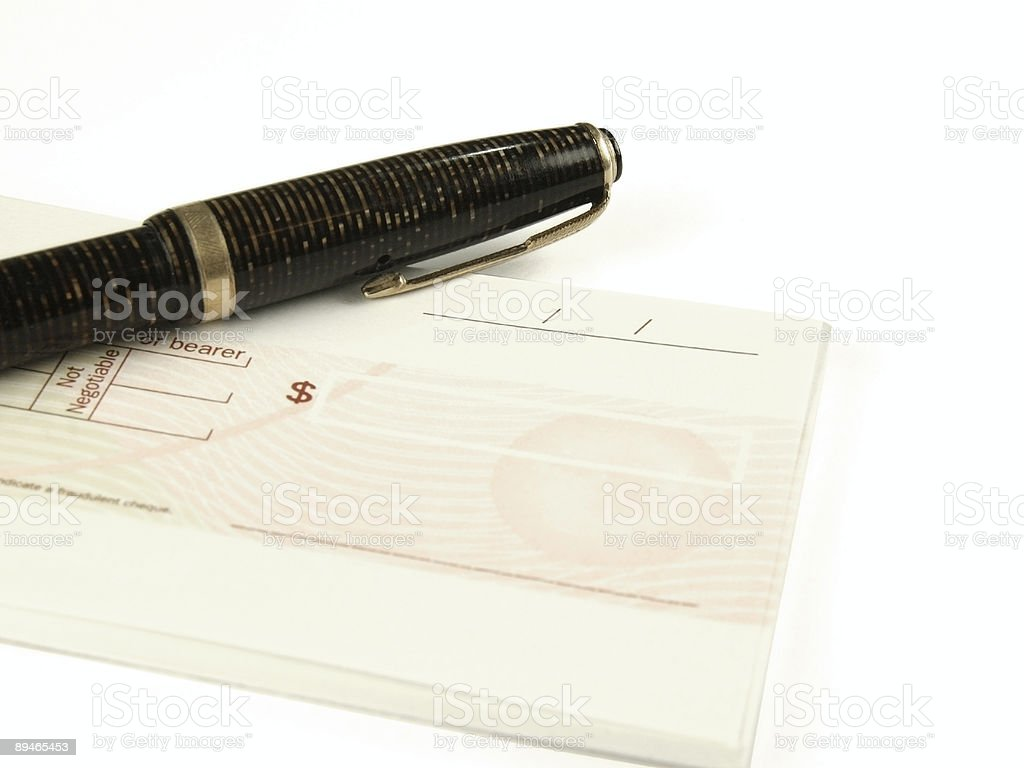 Fountain pen on check book royalty-free stock photo