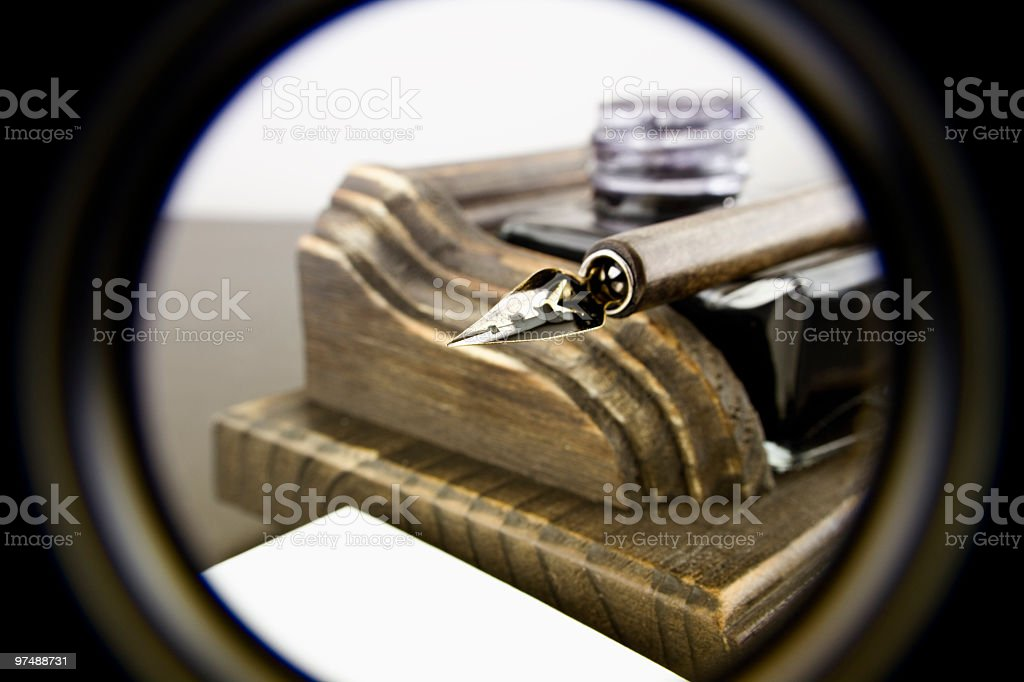 Fountain pen on ink pot and white book royalty-free stock photo