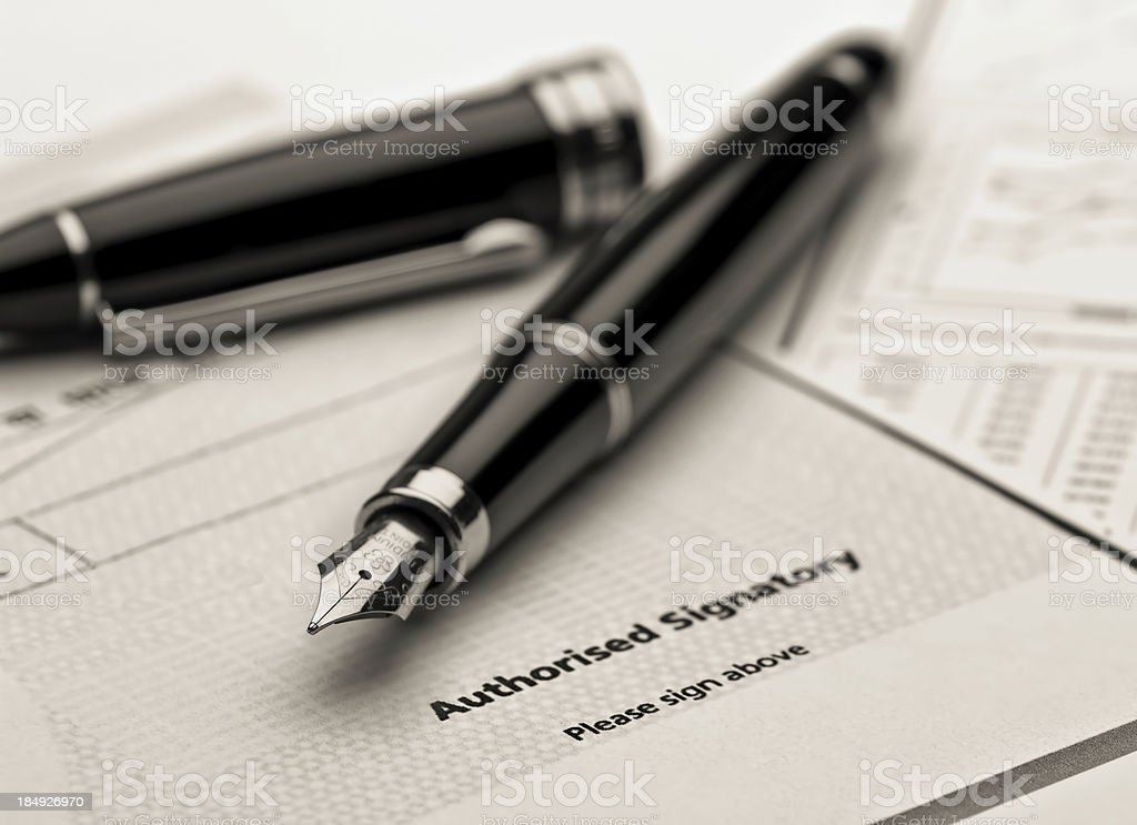 Fountain pen on legal document. royalty-free stock photo