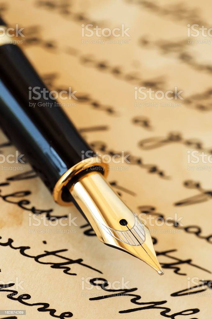 Fountain pen on letter royalty-free stock photo