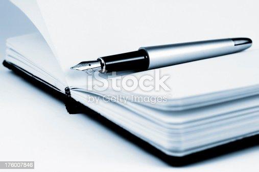 istock Fountain pen on notebook 176007846