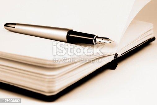istock Fountain pen on notebook 176008892