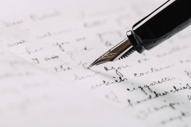 caneta fonte em papel com close-up texto de tinta - mensagem - fotografias e filmes do acervo
