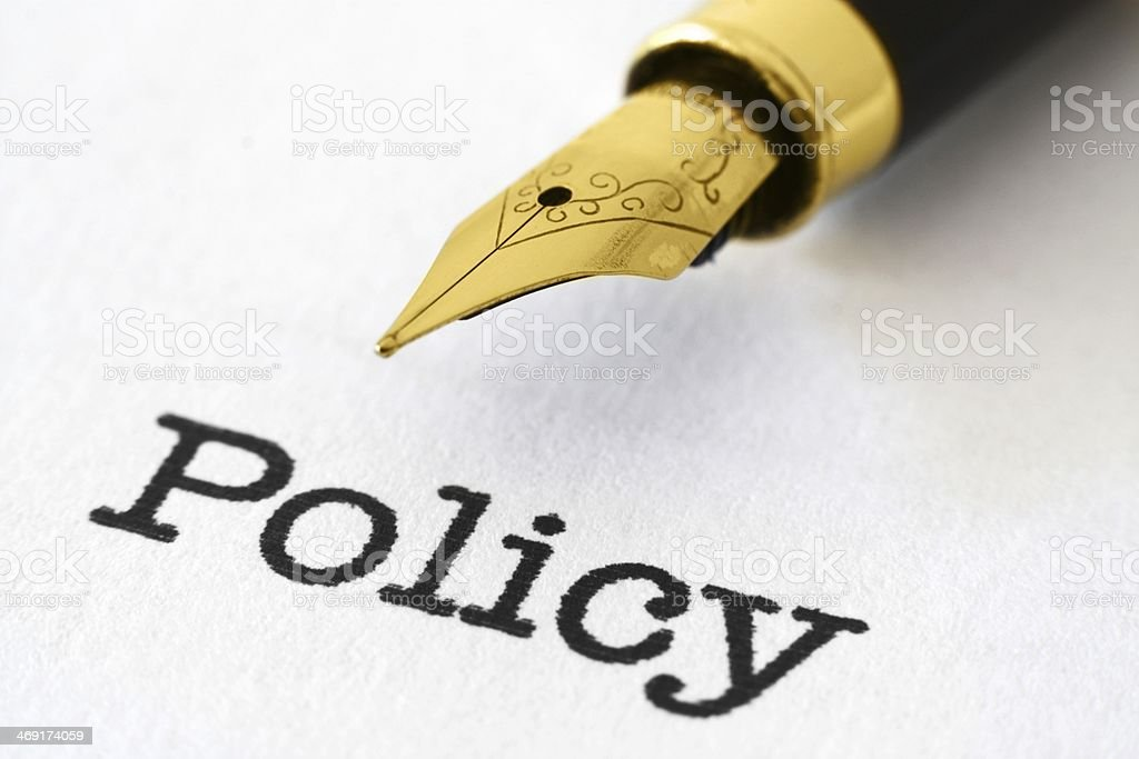 Fountain pen on policy stock photo